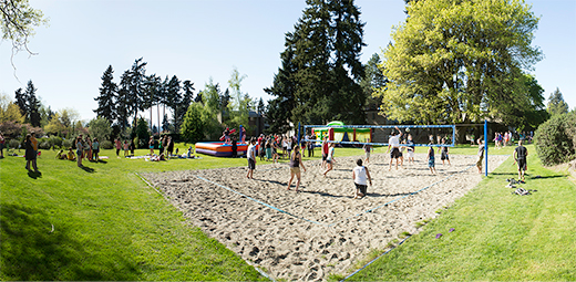 Students Playing Beach Volleyball on Campus