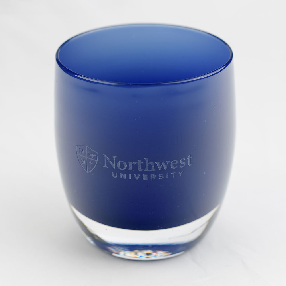 a glassybaby with the Northwest University logo etched into it