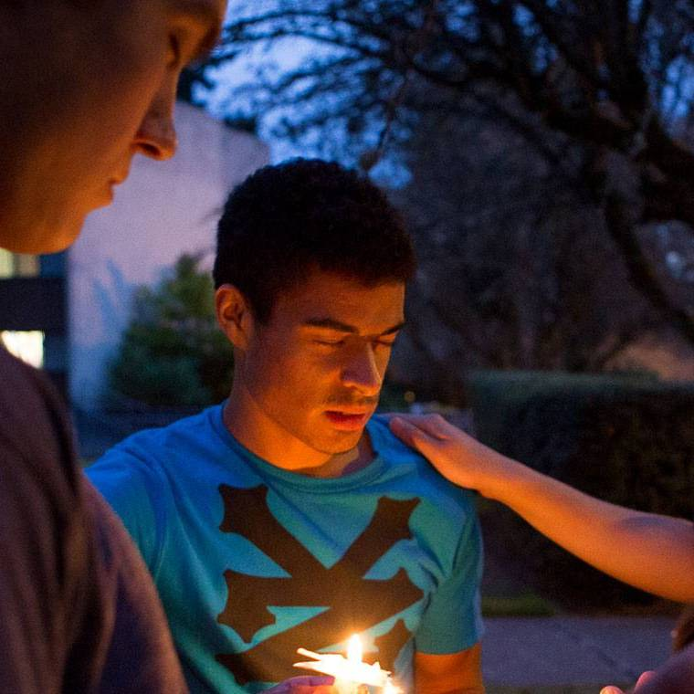 Students pray together for the coming school year holding candles in the evening.
